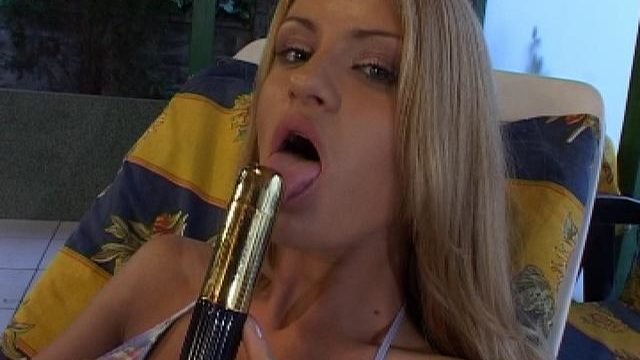 Incendiary Blonde Honey Licking And Sucking A Large Toy On The Poolside